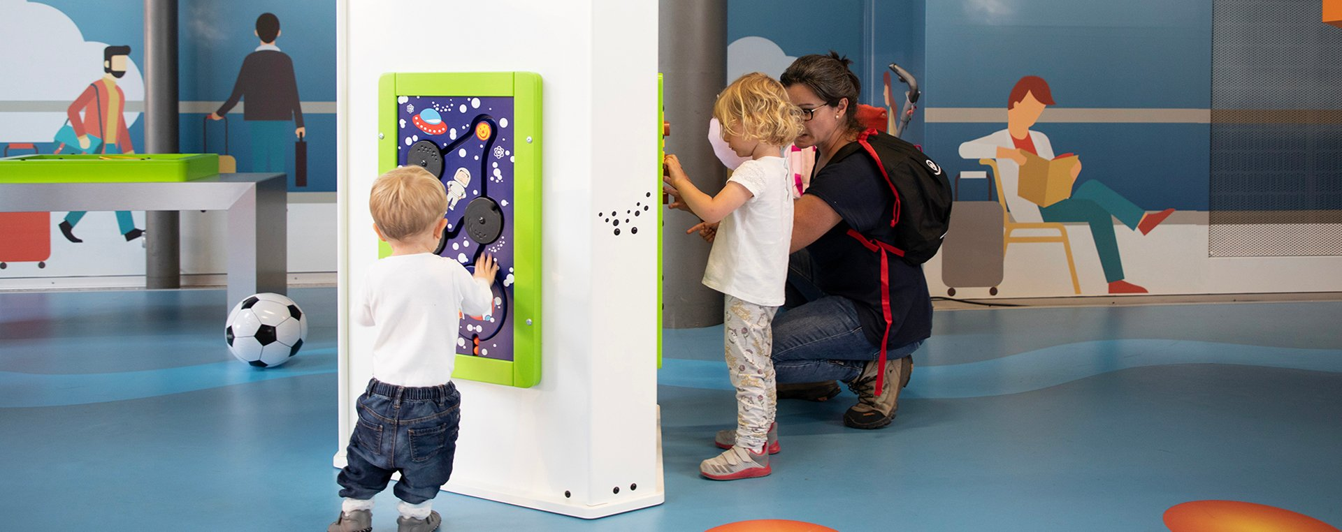 this image shows a kids corner with wall game  in an airport